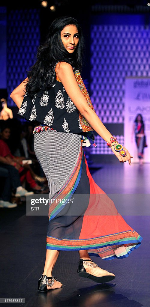 An Indian model showcases a creation by designer Anita Dongare during the Lakme Fashion Week (LFW) Winter/Festival 2013 in Mumbai on August 25, 2013.