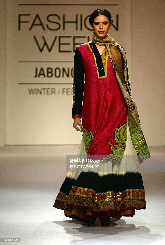 An Indian model showcases a creation by designer Ekru on the third day of Lakme Fashion Week (LFW) Winter/Festival 2014 in Mumbai on August 22, 2014. The LFW, is held twice annually, featuring creations by over 86 designers and will culminate on August 24.
