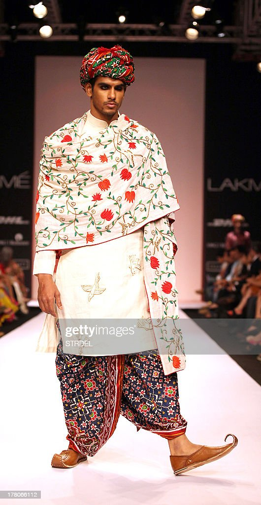 An Indian model showcases a creation by designer Gaurang during the Lakme Fashion Week (LFW) Winter/Festival 2013 in Mumbai on August 26, 2013.