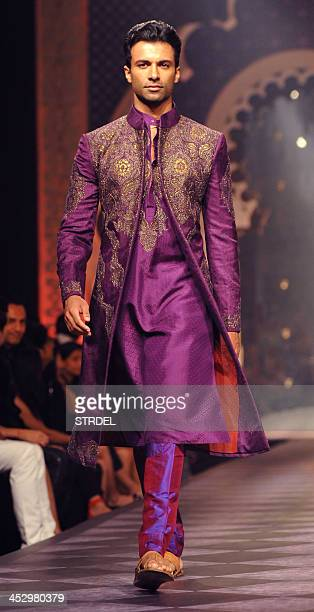 An Indian model showcases a creation by designer Raghavendra Rathore during the Aamby Valley India Bridal Fashion Week 2013 in Mumbai late December 1...
