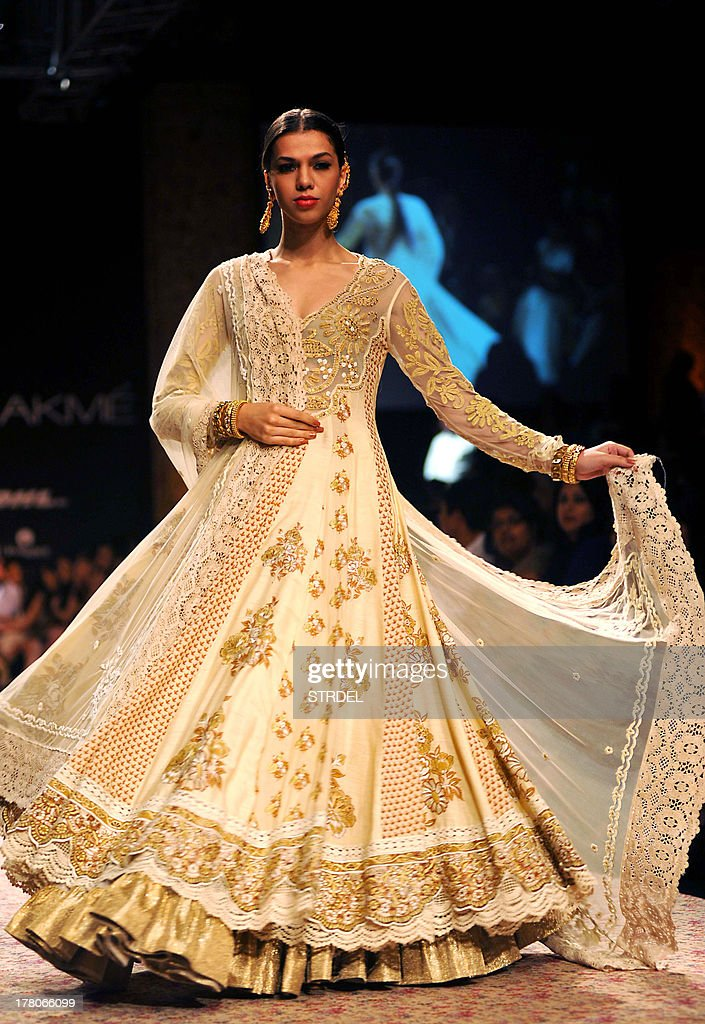An Indian model showcases a creation by designer Ritu Kumar and jewellery by Reliance during the Lakme Fashion Week (LFW) Winter/Festival 2013 in Mumbai on August 26, 2013.