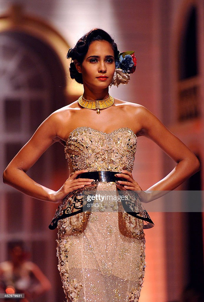 An Indian model showcases a creation by designers Falguni & Shane Peacock during the Aamby Valley India Bridal Fashion Week 2013 in Mumbai late December 1, 2013.