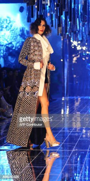 An Indian model showcases creations by designer Manish Malhotra during the grand finale of Lakme Fashion Week Winter/Festive 2017 in Mumbai on August...