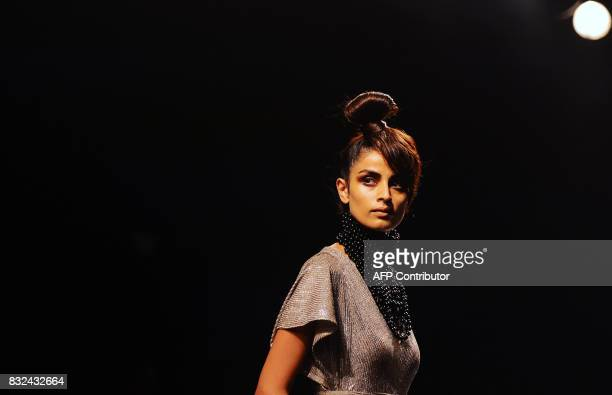 An Indian model showcases creations by designer Shweta Kapur at Lakme Fashion Week Winter/Festive 2017 in Mumbai on August 16 2017 Lakme Fashion Week...