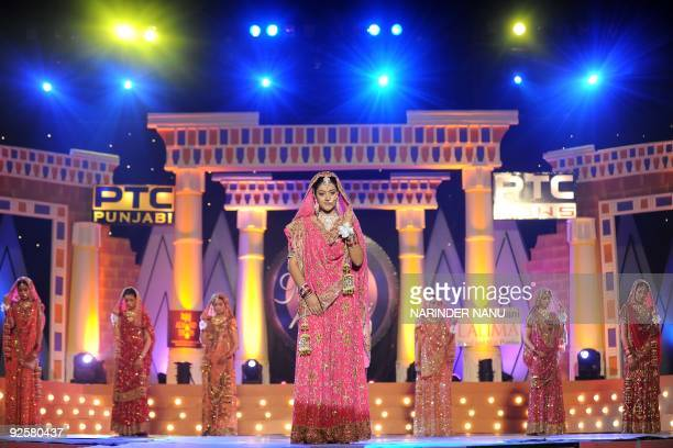 An Indian model walks the ramp wearing a traditional wedding dress during the Vivel Miss PTC Punjabi 2009 contest at Khalsa College in Amritsar late...