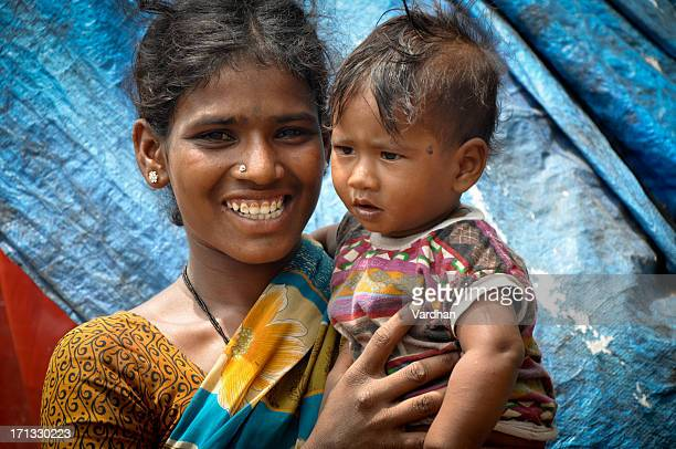 An Indian mother happily holding her baby girl