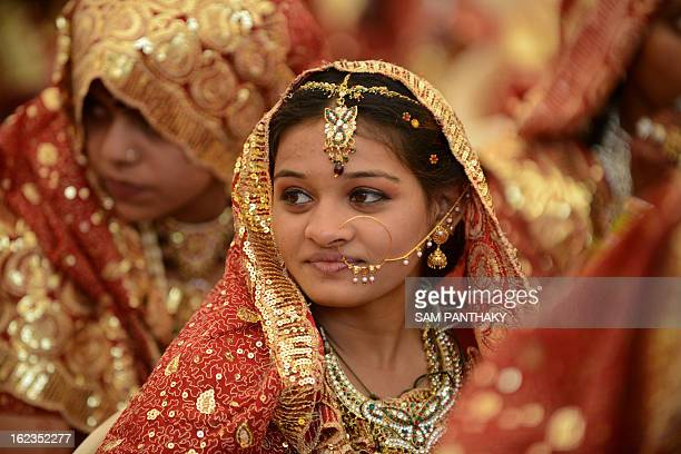 An Indian Muslim bride gestures during a mass wedding ceremony at the ancient Sarkhej Roja in Ahmedabad on February 22 2013 Some 151 couples...