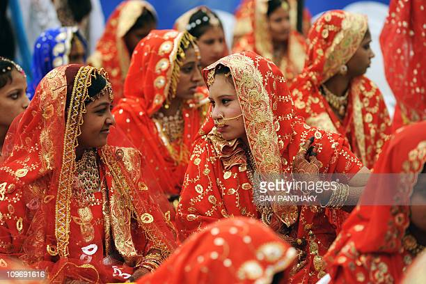 An Indian Muslim brides wait for the start of a mass wedding in Ahmedabad on March 21 2010 Some 201 Muslim couples participated in a mass wedding...