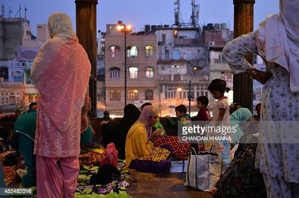 An Indian Muslim devotee offers prayers during the Islamic holy month of Ramadan at a mosque in New Delhi on July 21 2014 During the holy month of...