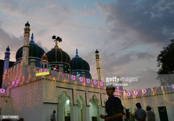 An Indian Muslim leaves after offering prayers on the eve of Eid alFitr marking the end of the holy month of Ramadan in Allahabad on June 25 2017 /...