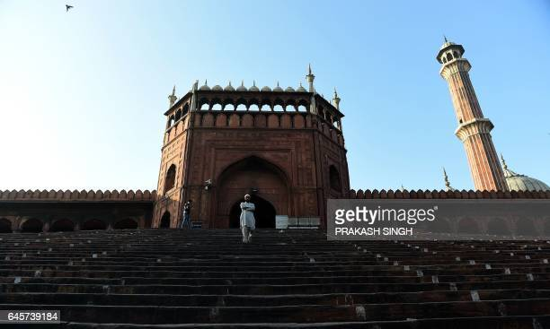 TOPSHOT An Indian Muslim man walks down the stairs of the Jama Masjid in the old quarters of New Delhi on February 27 2017 / AFP PHOTO / Prakash SINGH