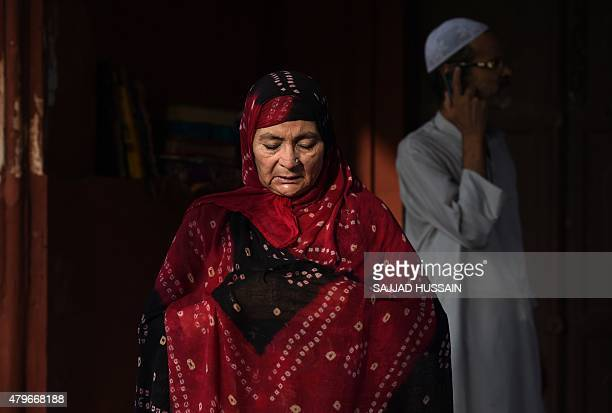An Indian Muslim woman offers prayers during the holy month of Ramadan at the Jama Masjid in the old quarters of New Delhi on July 6 2015 Across the...
