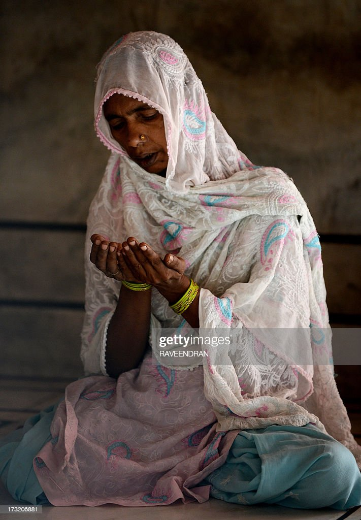 An Indian Muslim woman prays at Jama Masjid on the eve of Ramadan in New Delhi on July 10, 2013. Islam's holy month of Ramadan is calculated on the sighting of the new moon and Muslims all over the world are supposed to fast from dawn to dusk during the month.