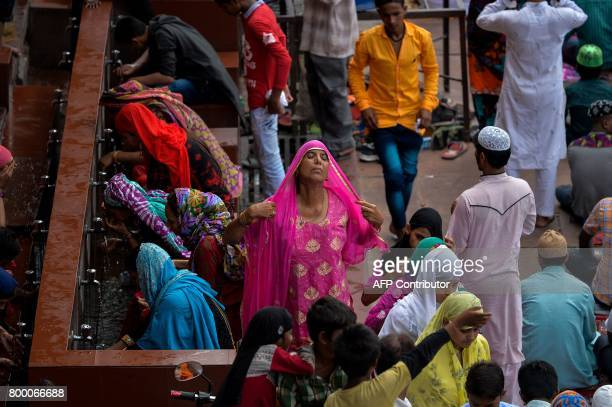 TOPSHOT An Indian Muslim woman prepares to offer prayer on the last Friday of the holy month of Ramadan at the Jama Masjid mosque ahead of the Muslim...