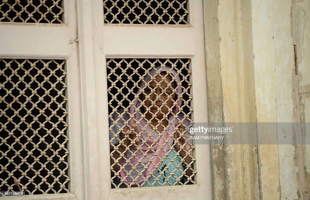 An Indian Muslim woman watches from behing a grilled door as Muslim brides and grooms participate in a mass wedding ceremony at the ancient Sarkhej Roza ... & An Indian Muslim woman watches from behing a grilled door as ... Pezcame.Com