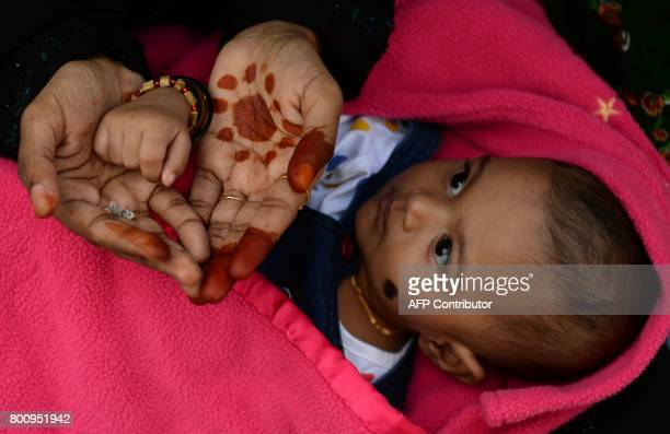 An Indian Muslim woman with her child offers Eid alFitr prayers in Chennai on June 26 2017 Muslims around the world are celebrating the Eid alFitr...