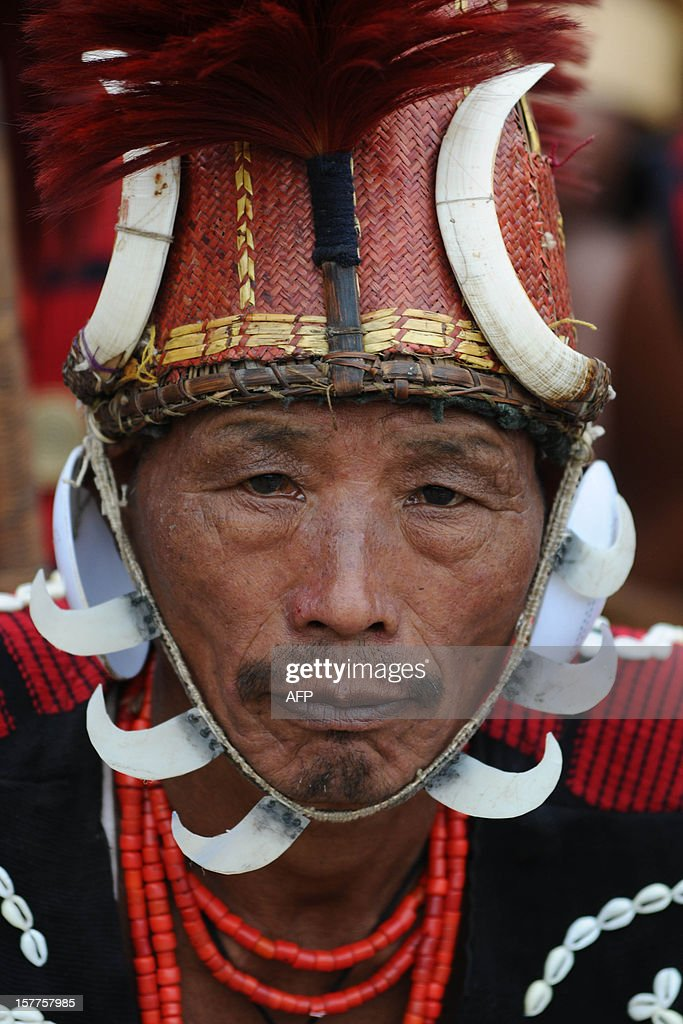 An Indian Naga tribesman in traditional headgear looks on during the Hornbill Festival at Kisama, some 15 kms from Kohima, India's Nagaland state on December 6, 2012. The week long Hornbill Festival of Nagaland, which celebrates the cultural heritage of the sixteen Naga tribes, runs annually from December 1-7.