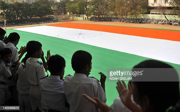 An Indian national flag is displayed at a school in Secunderabad on February 27 2012 The India tricoloir was measured at 225 feet by 150 feet...