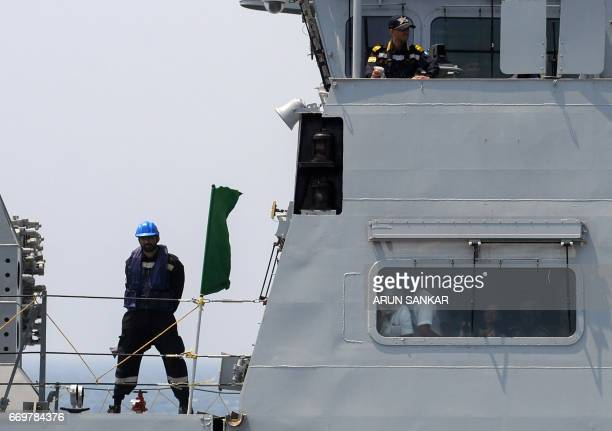 An Indian naval cadet stands guard on board India's naval ship INS Chennai during exercises in the Bay Of Bengal off the coast of Chennai on April 18...