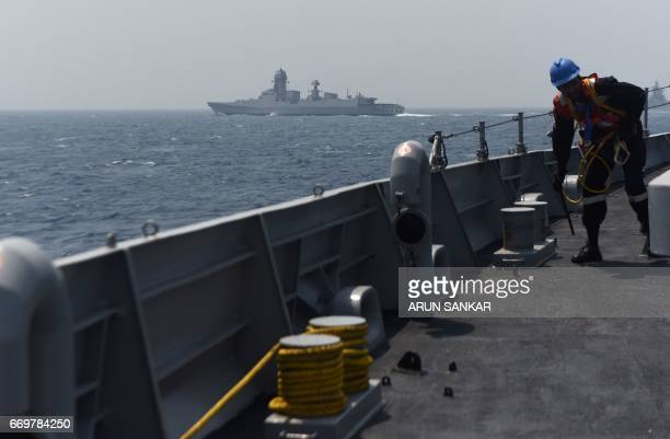 An Indian naval cadet takes part in a drill on board India's naval ship INS Sumedha during exercises in the Bay Of Bengal off the coast of Chennai on...