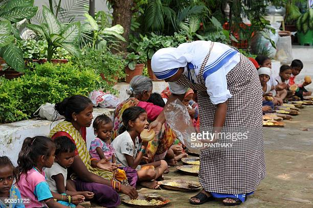 An Indian nun distributes food to those in need at Nirmala Sishu Bhavan in Ahmedabad on September 5 2009 The members of Missionaries of Charity paid...