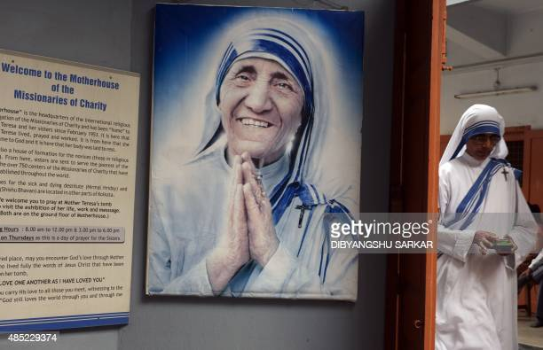 An Indian nun from the Catholic Order of the Missionaries of Charity leaves after taking part in a mass to commemorate the 105th birthday of Mother...
