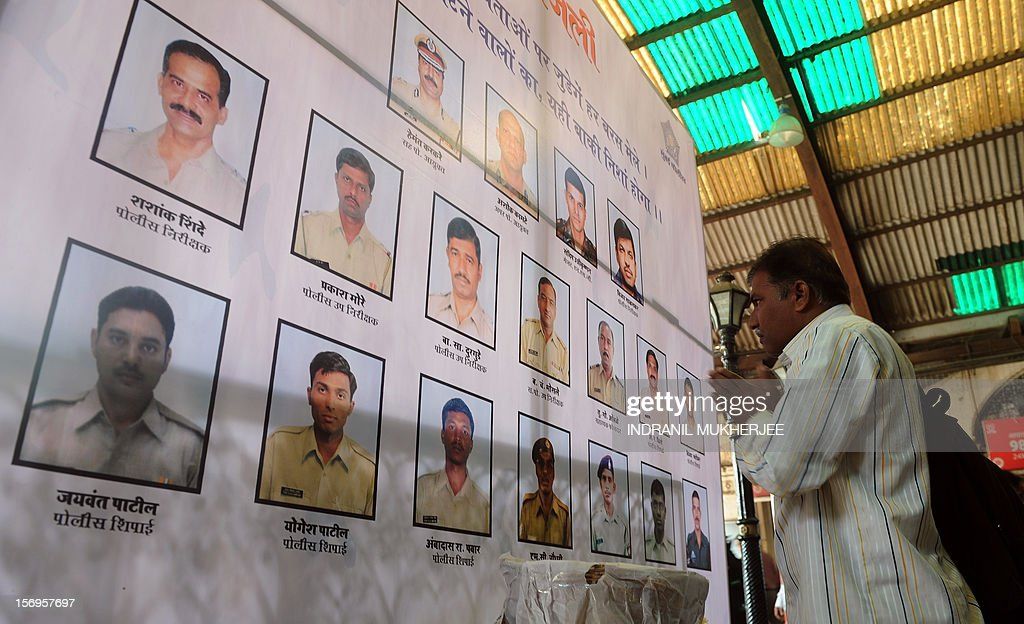 An Indian officer worker pays his respects to police and uniformed personnel who lost their lives in 2008 terror attacks outside a railway station in Mumbai on November 26, 2012. A total of 166 people were killed and more than 300 others were injured when 10 heavily-armed Islamist militants stormed the city on November 26, 2008, attacking a number of sites, including the city's main railway station, two luxury hotels, a popular tourist restaurant and a Jewish centre.