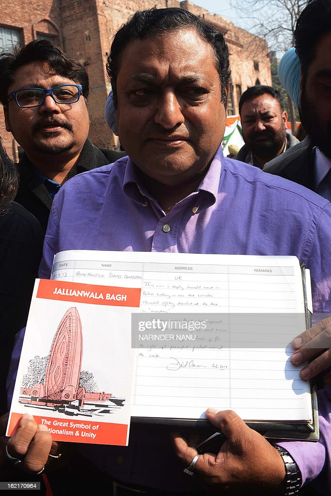 An Indian official displays the visitor book after British Prime Minister David Cameron wrote his remarks at Jallian wala Bagh memorial in Amritsar on February 20, 2013. British Prime Minister David Cameron visited the site of a colonial-era massacre in India during his visit to Amritsar, describing the episode as 'deeply shameful' while stopping short of a public apology. On the last leg of a three-day trip aimed at forging deeper economic ties, Cameron took the bold decision to visit the city of Amritsar. AFP PHOTO/ NARINDER NANU