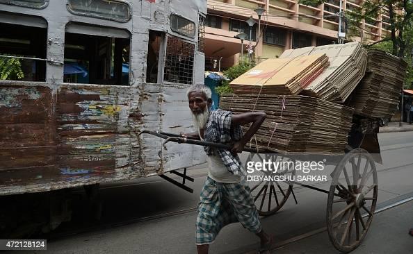 An Indian old rickshaw puller transports his load in Kolkata on May 4 2015 AFP PHOTO/ Dibyangshu Sarkar