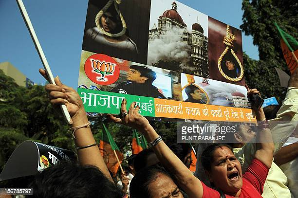 An Indian opposition Bharatiya Janata Party activist holds a placard as she and others celebrate the execution of Pakistanborn Mohammed Kasab who was...