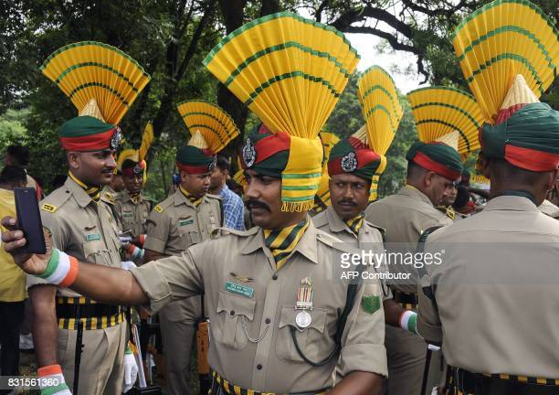 TOPSHOT An Indian paramilitary force member takes a selfie on a phone before marching during Independence Day celebrations in Agartala the capital of...