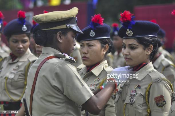 An Indian paramilitary soldier adjusts the dress of a colleague during Indian Independence Day celebrations in Agartala India on August 15 2017