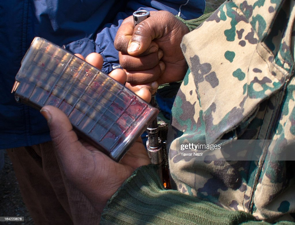 An Indian paramilitary soldier hold the magazine smeared in blood of his killed comrade after an attack by suspected militants this early morning on March 21, 2012 in Srinagar the summer capital of Indian administered Kashmir, India. One Indian Border Security Force (BSF) soldier was killed and two others wounded when suspected militants attacked their vehicle on a highway in the outskirts of Srinagar. The attack is the second in the last ten days after a suicide attack by militants left five Indian paramilitary soldiers dead in one of the deadliest attack's in the last five years. The Kashmir valley is on alert since the hanging of Afzal Guru, a local who was convicted of carrying out a deadly attack on the Indian Parliament attack in 2001.