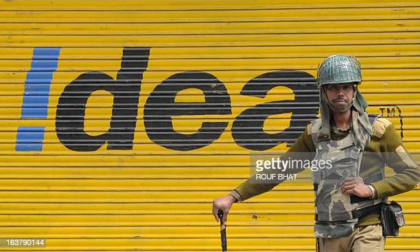 An Indian Paramilitary soldier stands guard during the third day of a curfew imposed on the Kashmiri summer capital in Srinagar on March 16 2013...
