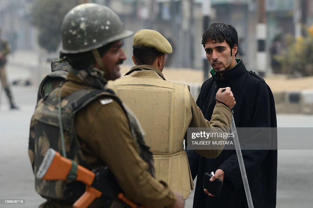 An Indian paramilitary soldier stops a Kashmiri pedestrian on an empty street during a restrictions for a Muharram procession in Srinagar on November 23, 2012. Authorities imposed restrictions in parts of Srinagar, the summer capital of Kashmir, to thwart planned Muharram processions as police detained more than a dozen protesters and fired teargas to disperse participants. AFP PHOTO/ Tauseef MUSTAFA