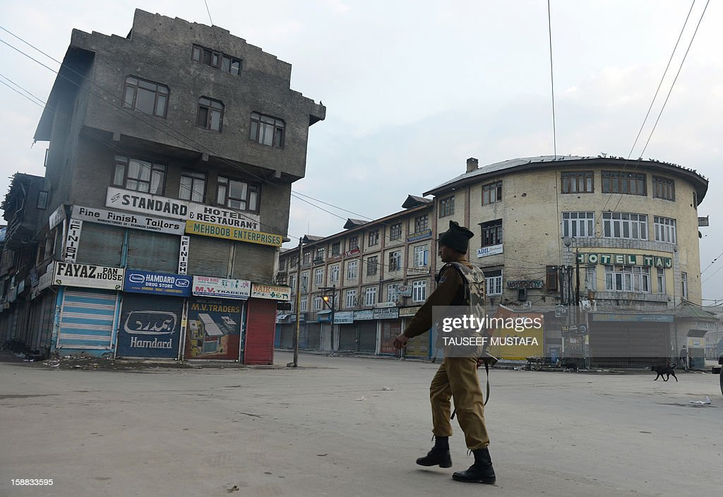 An Indian paramilitary trooper patrols during a one day strike in Srinagar on December 31,2012. Shops and businesses are shut in Kashmir in response to a strike called by separatist groups to protest shooting by government forces that wounded seven civilians. Last week Indian troops shot dead two suspected Islamic militants in Kashmir while seven civilians received bullet injuries when they protested the slaying of the rebels, officials said. AFP PHOTO/ Tauseef MUSTAFA