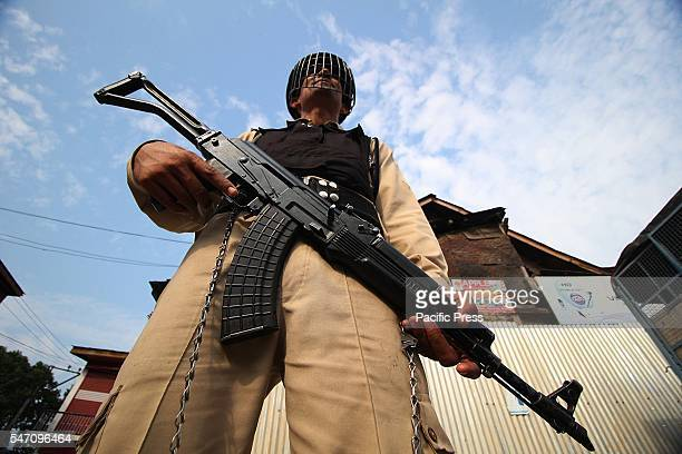 An Indian paramilitary trooper stand alert in curfew at old Srinagar the summer capital of India controlled by Kashmir
