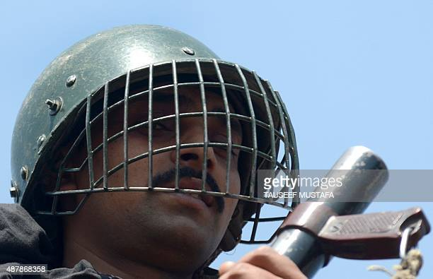 An Indian paramilitary trooper stands guard during a oneday strike called by separatists in downtown Srinagar on September 12 2015 Separatists led by...