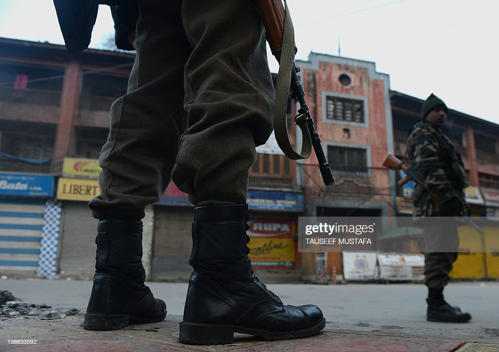 An Indian paramilitary trooper stands guard during one day strike in Srinagar on December 31,2012. Shops and businesses are shut in Kashmir in response to a strike called by separatist groups to protest shooting by government forces that wounded seven civilians. Last week Indian troops shot dead two suspected Islamic militants in Kashmir while seven civilians received bullet injuries when they protested the slaying of the rebels, officials said. AFP PHOTO/ Tauseef MUSTAFA