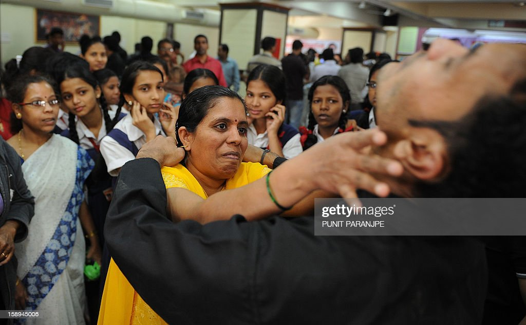 An Indian participant (C) practises a self defence with an instructor during a self-defence classes at a school in Mumbai on January 4, 2013. After nearly three weeks of lurid reporting on a horrifying gang-rape in New Delhi, women in the Indian capital say they are more anxious than ever, leading to a surge in interest in self-defence classes.