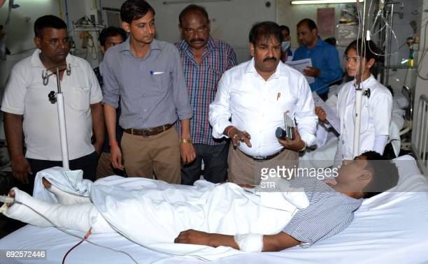 An Indian passenger injured in a bus collision is treated at the district hospital in Bareilly in India's Uttar Pradesh state on June 5 2017 At least...