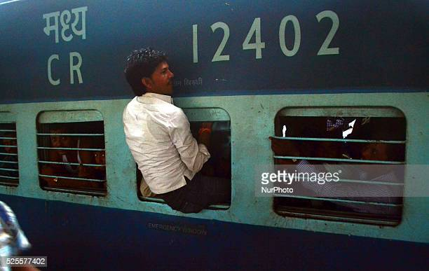 An indian passenger try to get in the over crowded trainon world Population dayin Allahabad on July 112015 The United Nations backed dayaims to raise...