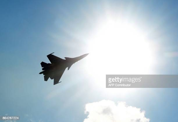 An Indian pilot flies a Sukhoi fighter jet during an event to mark the 85th anniversary of the Indian Air force at Bamhrauli Air Force Station in...