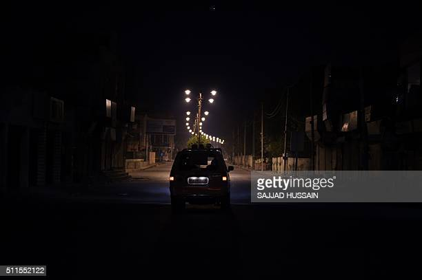 An Indian police car patrols following caste violence in Rohtak on February 21 2016 Fresh rioting and arson erupted in a north Indian state February...