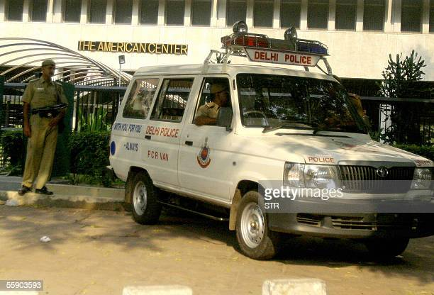 An Indian police car stands outside the American Centre in New Delhi 12 October 2005 The US embassy and consulates in India will carry on business as...