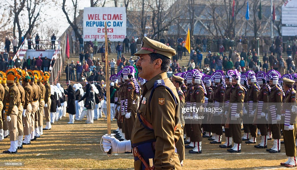 An Indian police officer stands in formation during India's Republic Day celebrations on January 26, 2013 in Srinagar, the summer capital of Indian Administered Kashmir. All businesses, schools and shops were closed and traffic remained off the roads following a strike call given by Kashmiri separatist leaders against India's Republic Day celebrations in Kashmir. Meanwhile India deployed large numbers of Indian police and paramilitary forces to prevent any incidents during the official celebrations.