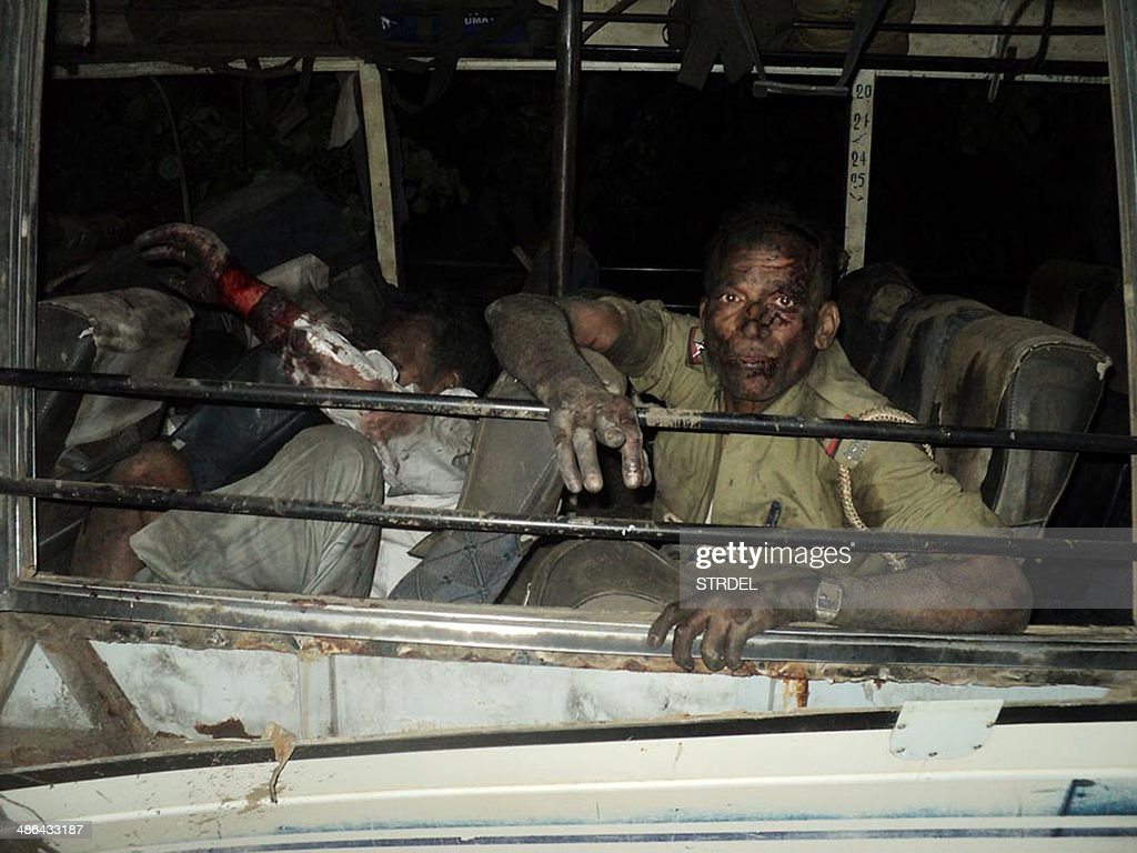 An Indian police official reacts after a suspected Maoist rebel attack on a convoy of election officials at Sikaripara in Dumka District some 230kms...