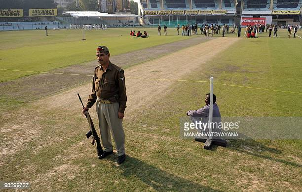 An Indian police official stands guard at the Green Park Stadium in Kanpur on November 22 2009 ahead of the second cricket Test match between India...