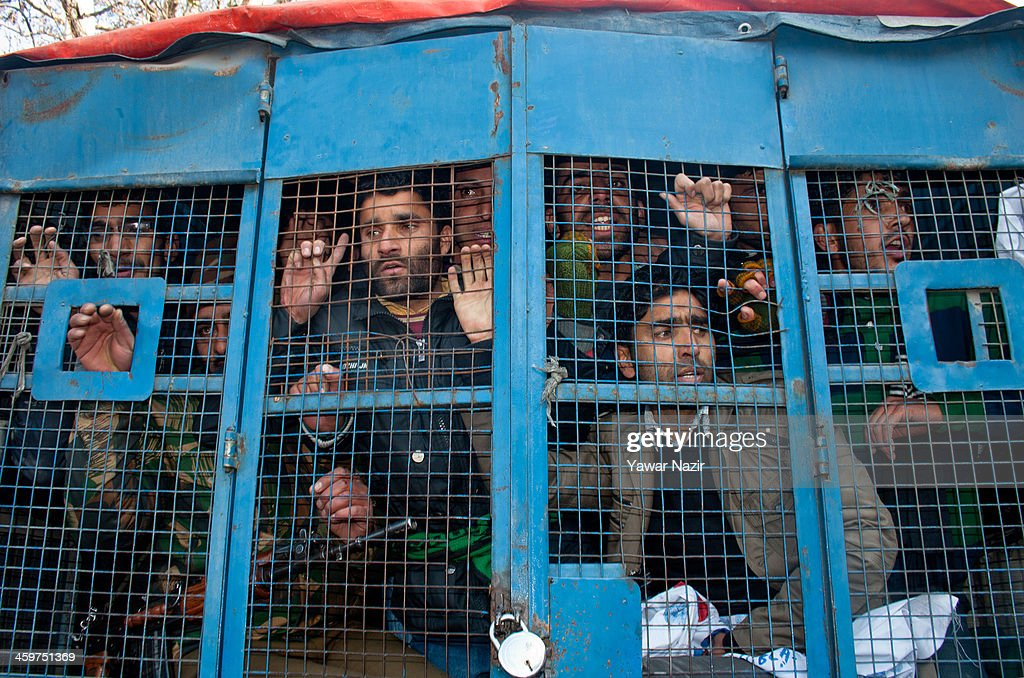 An Indian police vehicle carrys detained trainers (Preraks) employed under Sakshar Bharat Mission, a scheme sponsored by Indian government during a protest against the government for not paying their salaries on December 30, 2013 in Srinagar, the summer capital of Indian administered Kashmir, India. Dozens of Preraks employed under the scheme, sponsored by the Indian government, were injured after Indian police attempted to disperse the crowd using batons. The group was protesting against the Government for non-payment of their honorarium, due for the last two years.