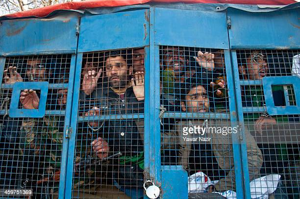 An Indian police vehicle carrys detained trainers employed under Sakshar Bharat Mission a scheme sponsored by Indian government during a protest...